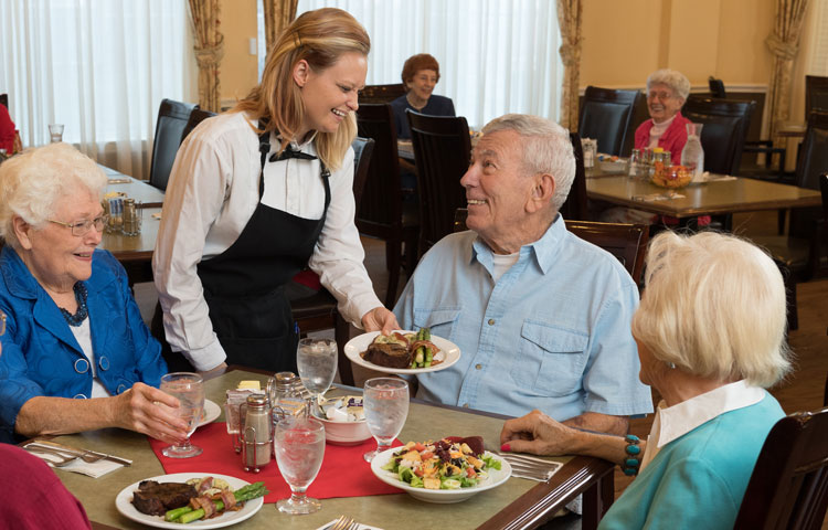 At the table - a lot of happy dining people image